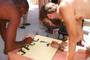Volunteers and youths working together