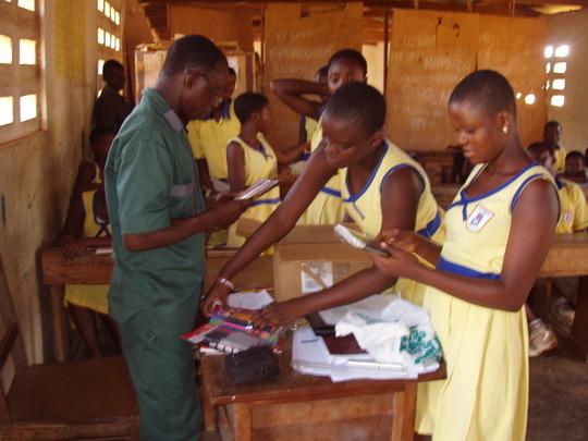 Children gratefully received pen donations
