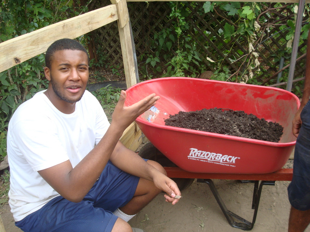 Young man with compost for growing more food.