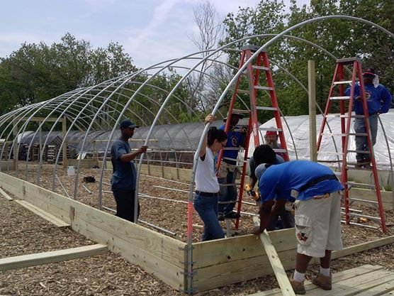 A hoophouse is built during our weekend workshop