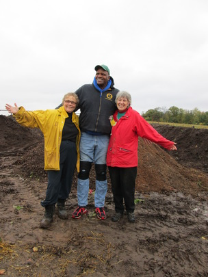 Jacque, Will Allen, and Karen on the compost pile