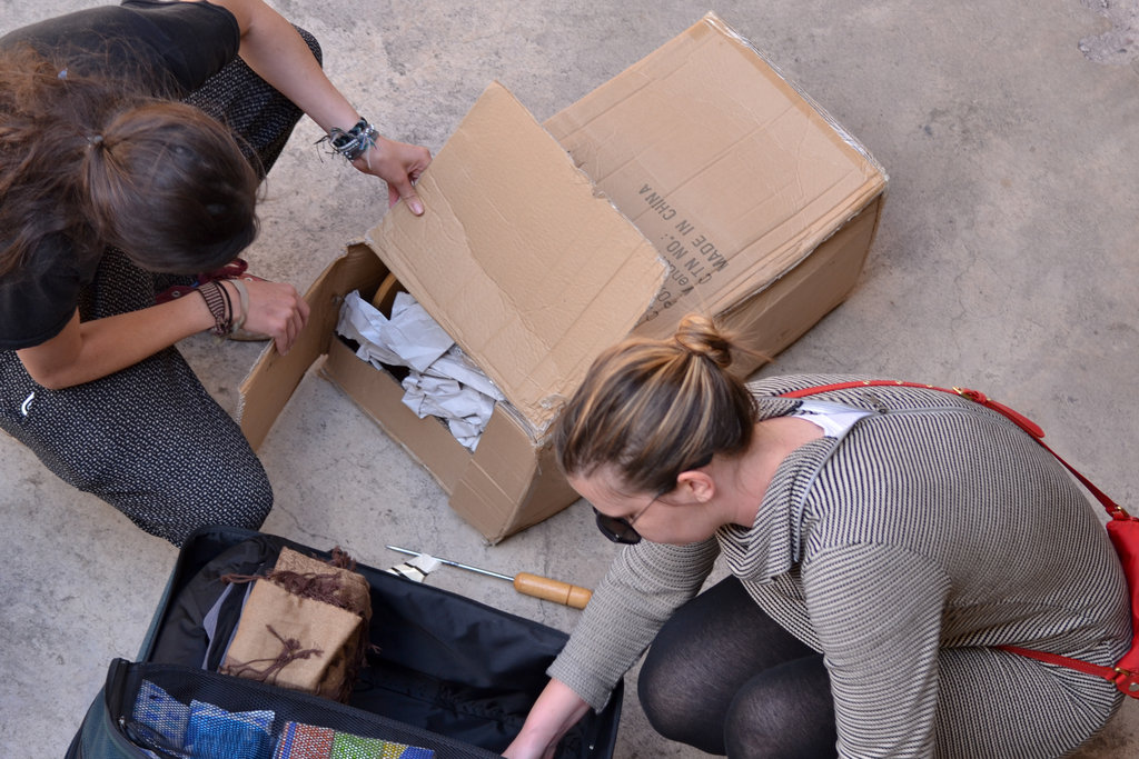 Volunteers unpack the carder after its trip down!
