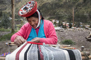Juliana works on a new textile.
