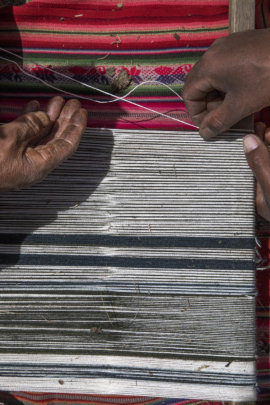Two weavers of Patacancha weave together.