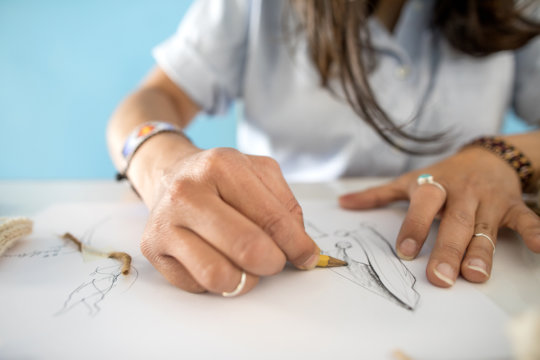 Alejandra sketching for Kay Pacha collection