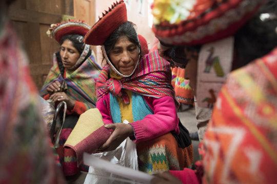 Toribia reviews the next textile samples.