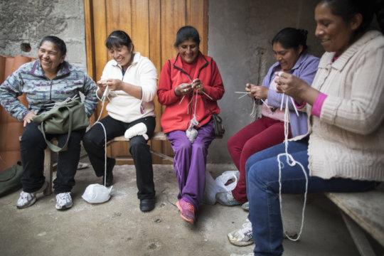 Rosa, Matilda, Demi, Yudi, & Isabel knit together.