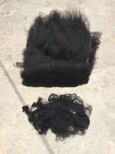 Black alpaca before and after carding