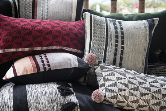 A pile of new pillows from our Home collection.