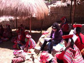 Discussing textile specifications with weavers