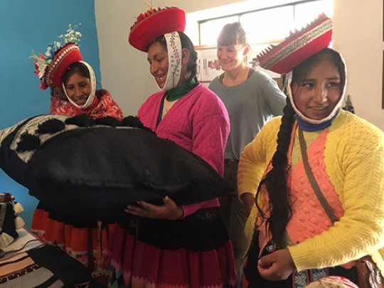 Weavers from Patacancha view the finished products