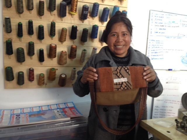 Estela with a leather bag