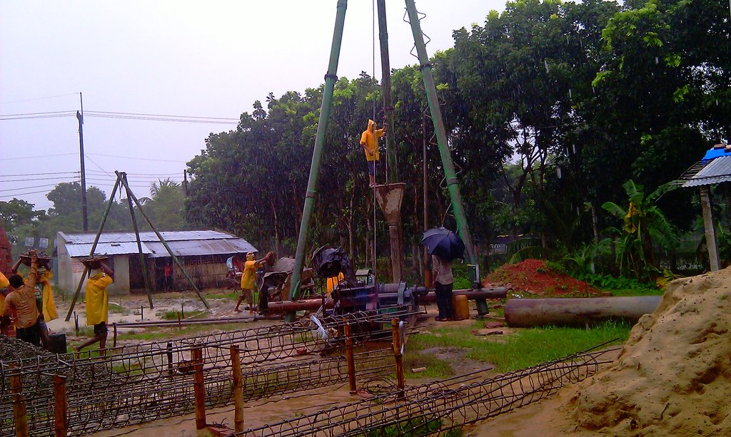 construction work in the rain at the hospital