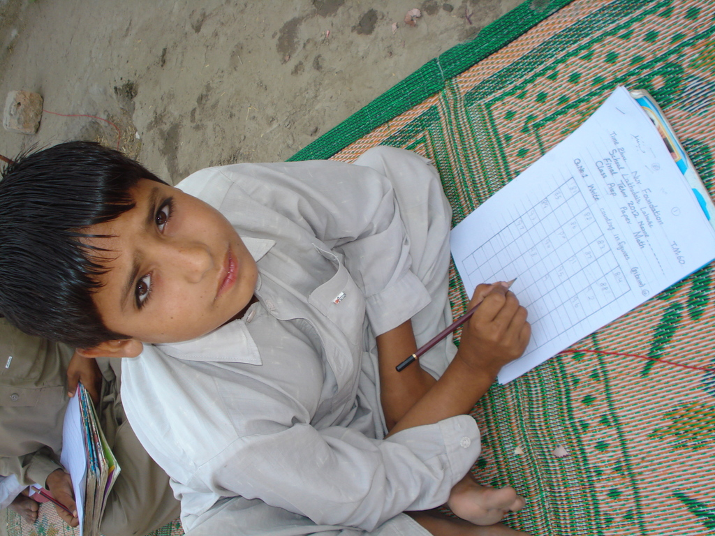 A child sitting for his final exams