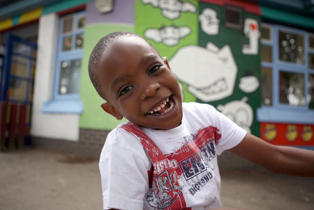 Boy who is having a great time on his short break at KIDS Hayward Adventure Playground in Islington, London