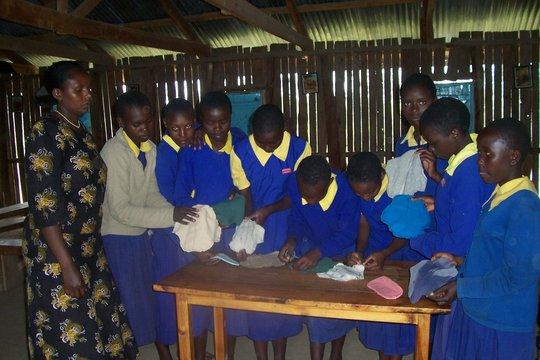 Girls practicing making sanitary pads