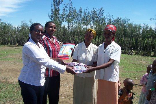 Project Leader Monicah Wairimu w/ school teachers