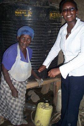 Monicah w/Mary Wangeci and her water tank