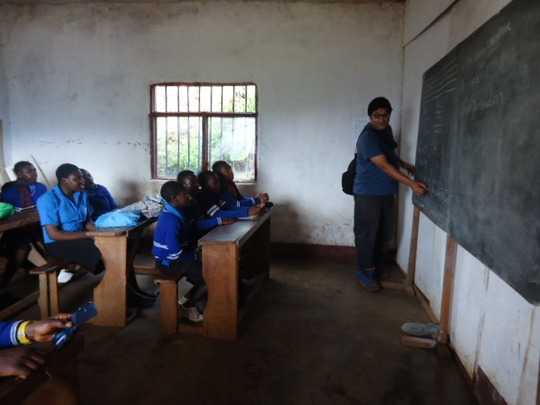 A Volunteer teaching the OVCs in Class