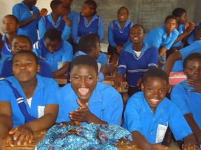 students sitting /singing  during moral education