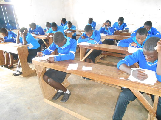 Students writing promotion exams