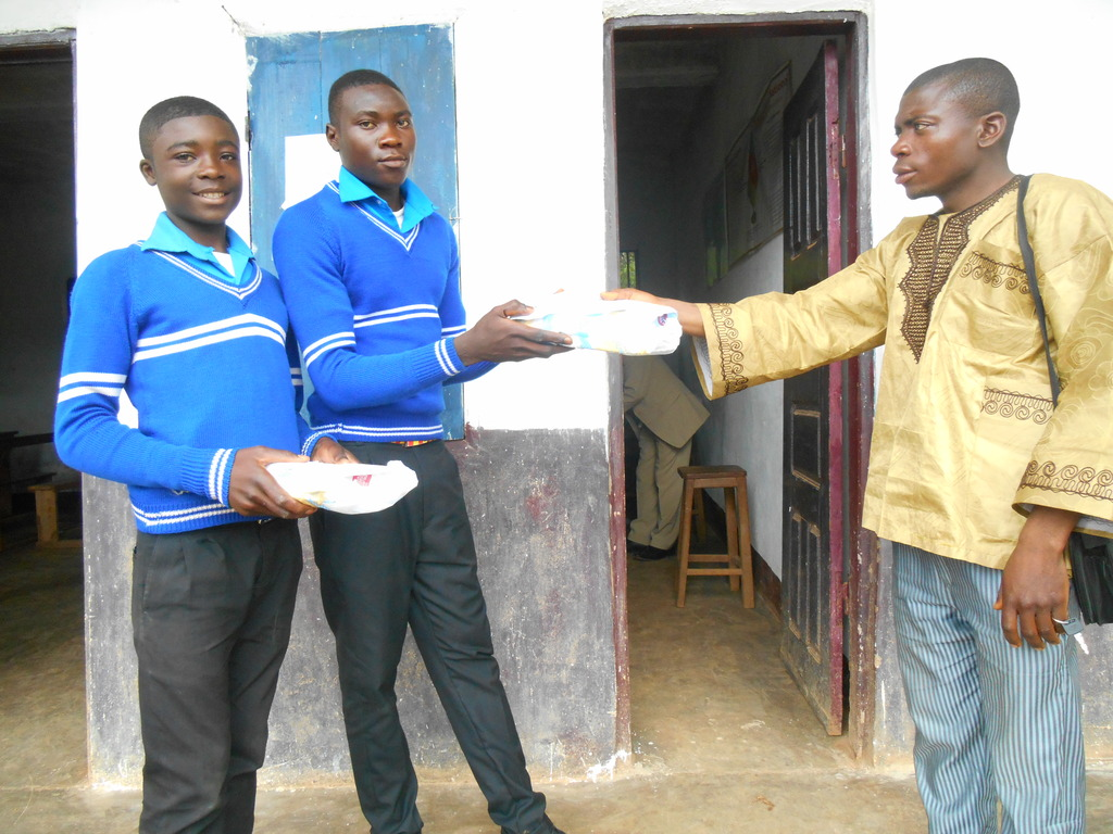 Some OVCs receiving Exercise books