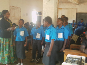 Students standing and singing a Christmas song