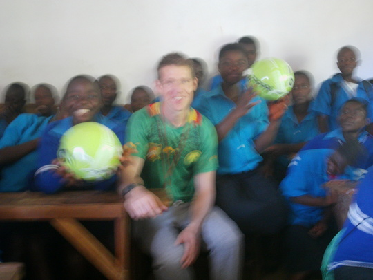 Volunteer Jon and the OVCs in class