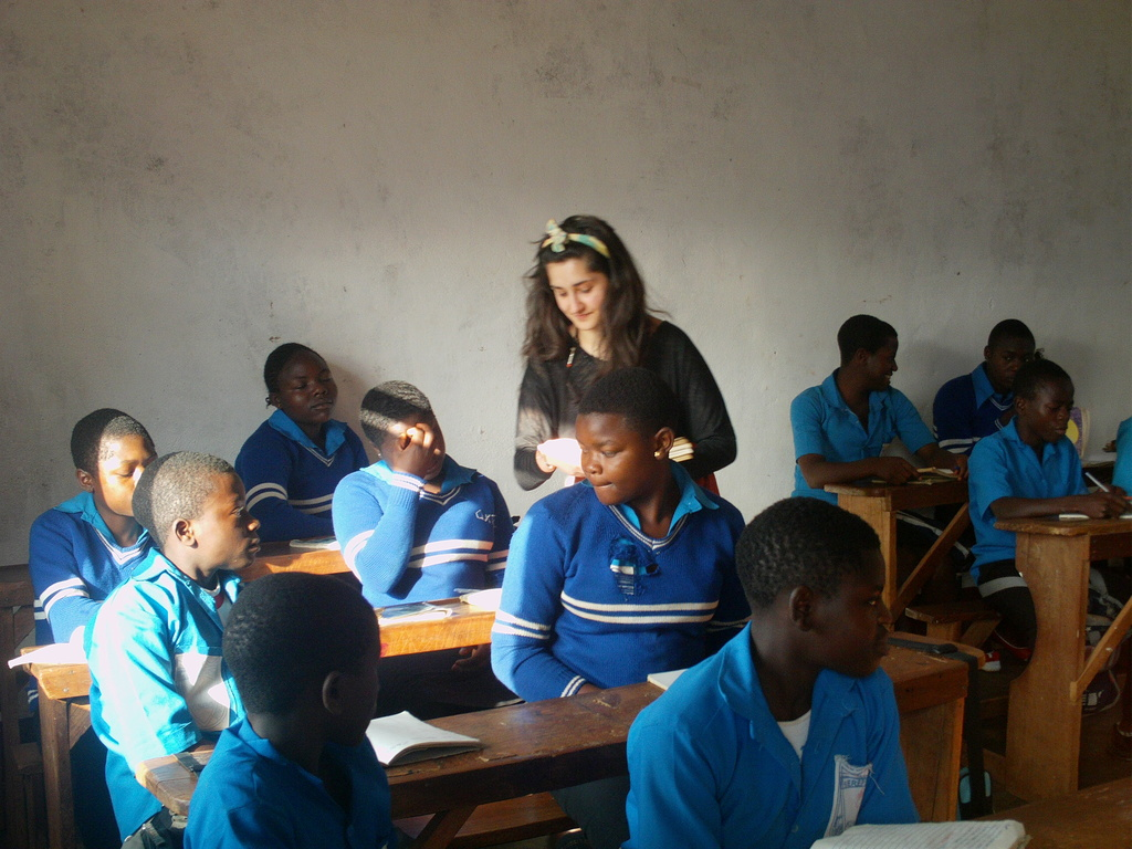 OUr voluteer teaching the orphaned children