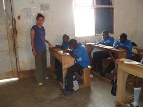 Volunteer teaching OVCs English Language in Class