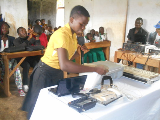 A student giving a presetation on office equipment