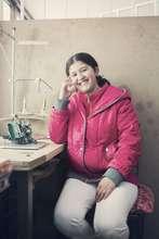 Maria at her seamstress shop
