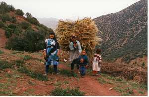 Women carrying bundles