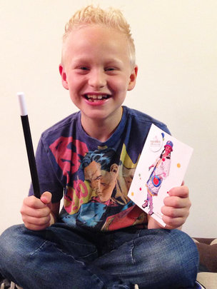 Thomas holding his wand and postcard from Dr Faffy