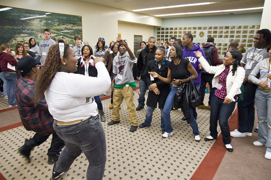 Students dancing during conference registration