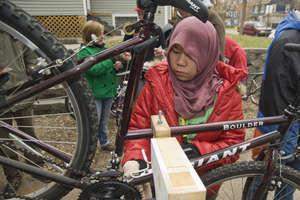Student repairing bikes for Open Roads