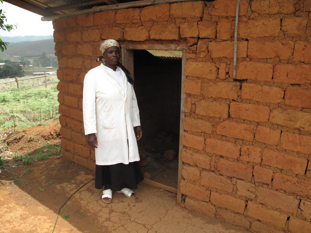A nurse infront of the Kitchen