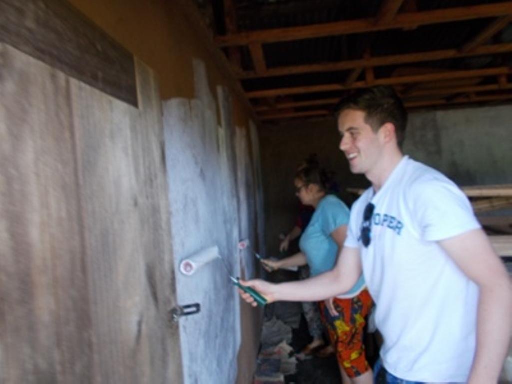 Volunteers  painting seriously