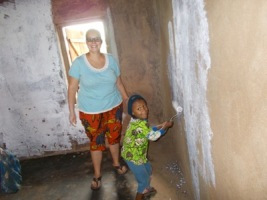 |AVolunteer  a small fulani hapily painting