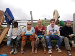 Volunteers resting after working  on painting