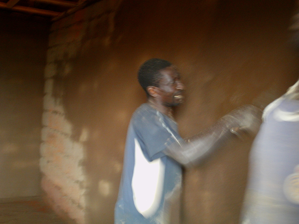 Bricklayer seriously plastering the walls