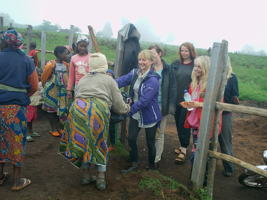 Cross section of women with volunteers at the site