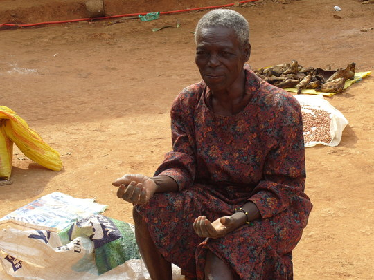 A woman  in mbosha thanking donors for their help