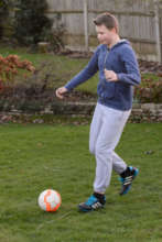 Joe playing football