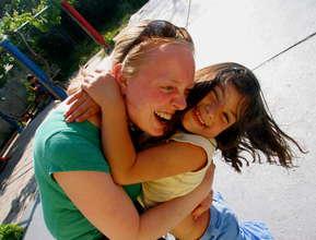 VE Global Volunteer with Child
