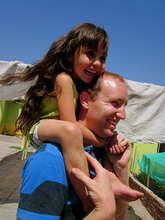 VE Global Volunteer with Child at Domingo Savio