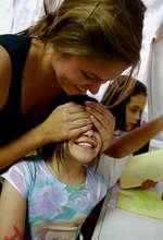 VE Global Volunteer with Child at Festival de Arte