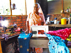 Asanar Janufa and one of her new sewing machines