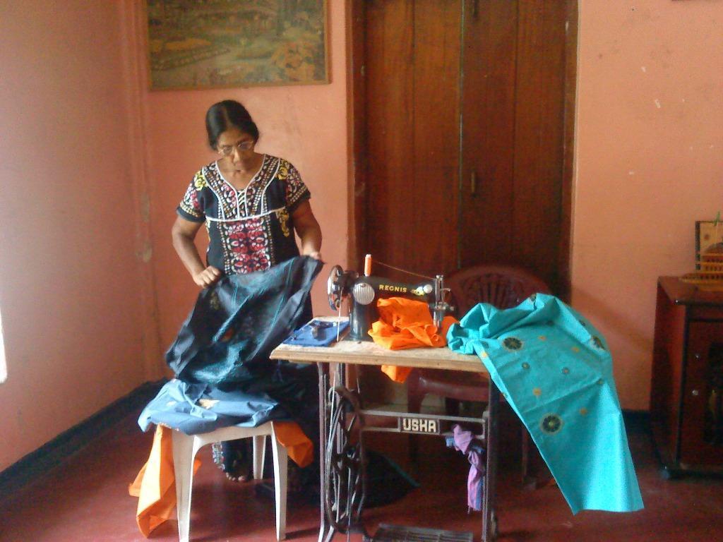 Mrs. Nallammah Vadivel Chooses Fabric for a Dress