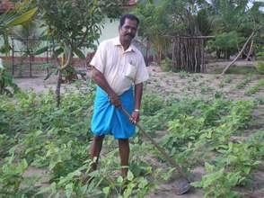 Selvam working on his farm